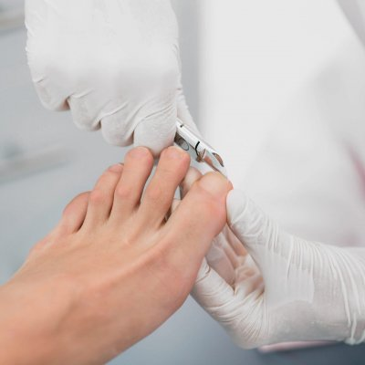 Beautician trimming clients Toenail. Hygienic Manicure Process